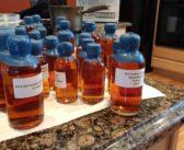 Wax sealing sample bottles